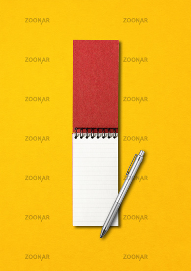 Blank open spiral notebook and pen isolated on yellow
