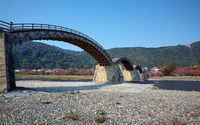 The famous historical wooden arch Kintai Bridge in Iwakuni city in the fall, Japan