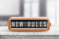 New rules alarm message on a wooden desk