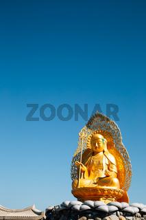 Golden buddha statue at Haedong Yonggungsa Temple in Busan, Korea