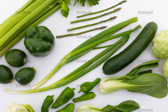 Celery, cucumber, spring onion and peppers on white background