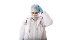 Anguished overworked doctor with head in hands during pandemic