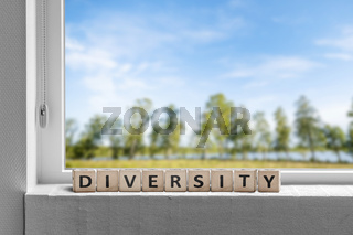 Diversity word in a window sill with a garden