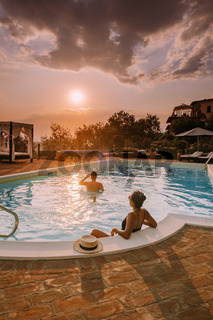 Luxury country house with swimming pool in Italy, Couple on Vacation at luxury villa in Italy, men and woman watching sunset