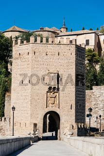 Alcantara Bridge against Toledo cityscape