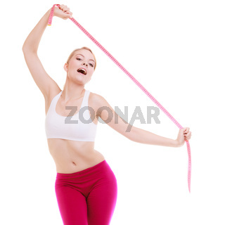 sporty fit woman with measure tapes. Time for diet slimming.