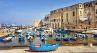 Fishing boats at the old port of Porto Vecchio in Monopoli Puglia Italy