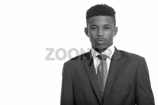 Young handsome African businessman wearing suit in black and white