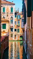 Old houses by canal in Venice