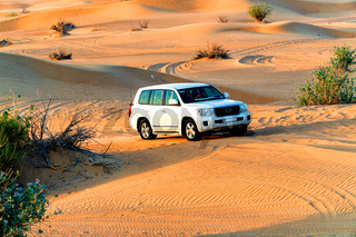An off-road vehicle in the desert dunes during an excursion