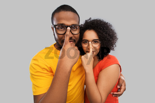 happy african american couple in glasses hugging