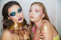 Two lovely young women with creative make-up