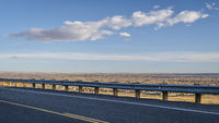 highway at Colorado foothills with a view of plains