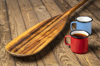 blade of old wooden canoe paddle with tea