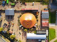 Aerial view of a circus tent colorfull red yellow entertainment show drone shot