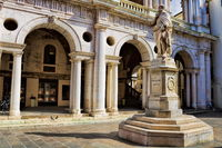 Vicenza, Italy - March 19, 2019 - Statue of Andrea Palladio in front of the Basilica Palladiana