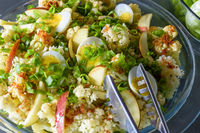 Salad with various fresh ingredients and eggs ready to be served