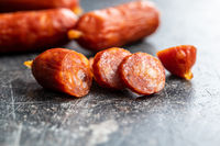 Sliced mini salami sausages.
