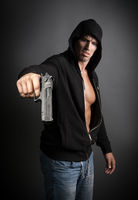 man shooting gun isolated on gray background