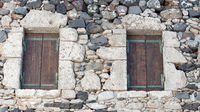 Stone wall texture with wooden doors as a background for composing