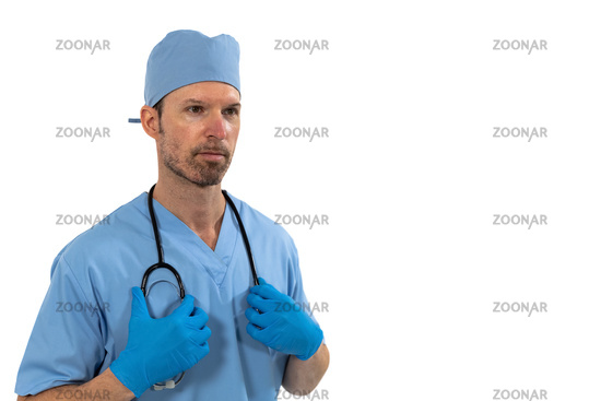 Male surgeon holding stethoscope against white background