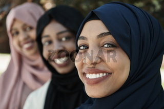businesswoman group portrait wearing traditional islamic clothes