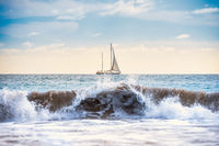 Seascape with white sailboat