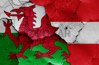 flags of Wales and Austria painted on cracked wall