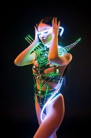 Girl in fantastic bdsm lingerie and uv lights shot