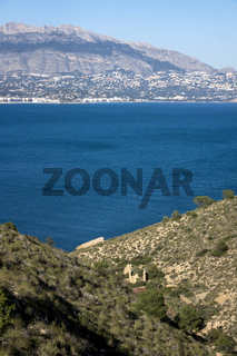 Natural park 'Serry Gelada' with view to Altea and ruin of ocher mine along the coast of Albir, Spain