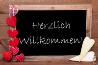Balckboard With Heart Decoration, Text Herzlich Willkommen Means Welcome