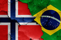 flags of Norway and Brazil painted on cracked wall