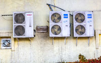 Different air compressors hanged on the wall