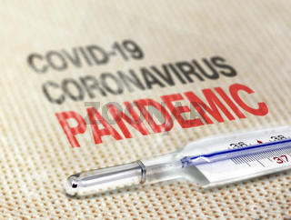 a thermometer resting on a soft surface indicating the Covid-19 Coronavirus pandemic.