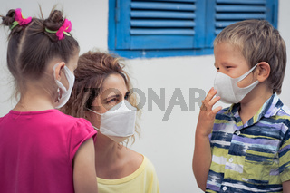 Family wearing facial disposable mask. Coronavirus protection