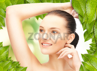 beautiful woman with green leaves