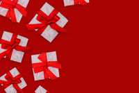 White gift boxes with red bows. Romantic holiday card for Valentine's Day, wedding or other event. Top view, copy space.