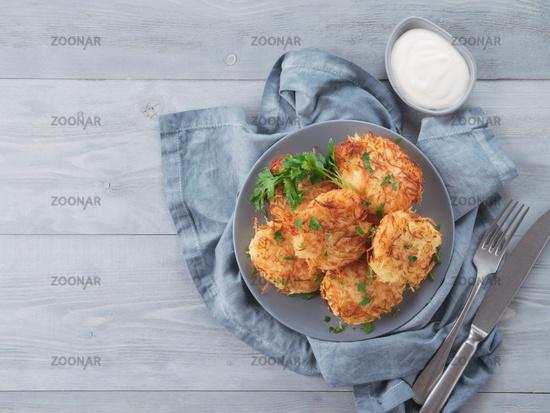 potato pancakes on gray tabletop, top view