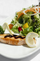 organic mixed vegetable salad with salmon fillet and balsamic vinaigrette
