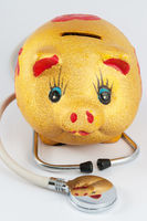 Piggy bank and stethoscope