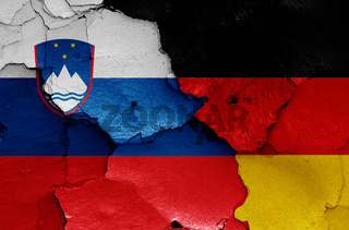 flags of Slovenia and Germany painted on cracked wall