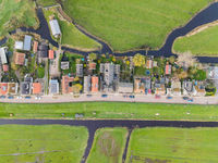 Top down view of dike houses and river grass the netherlands Holland natural housing a long the water classic
