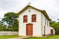Small withe old church and crucifix in colonial architecture