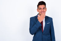 Portrait of happy young handsome multi ethnic businessman in suit