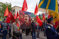 Anapa, Russia - May 9, 2019: People carry a portrait of Joseph Stalin along the streets of Anapa, at a festive procession dedicated to Victory Day on May 9