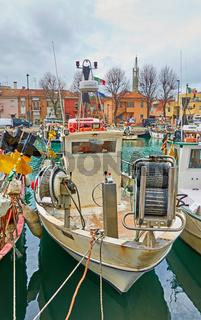 Fishing boat in canal in Rimini