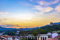 View of old houses and churches in colonial architecture from the 18th century at sunset in Ouro Preto city