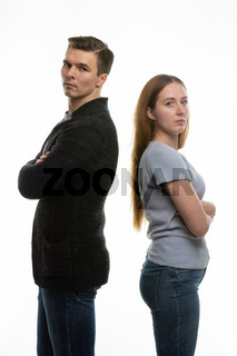 The couple got into a fight and standing with their backs to each other in the frame