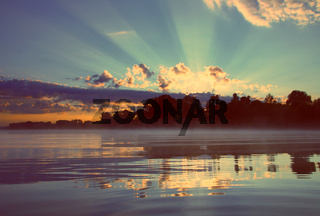 beautiful sunrise on river - vintage retro style