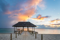 Panoramic pier over the indian ocean at sunset